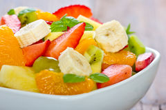 Fruit salad in the bowl Stock Images