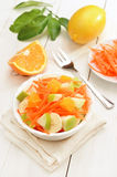 Fruit salad in bowl on white wooden table Royalty Free Stock Photography