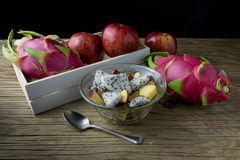 Fruit salad in a bowl on the wooden table. Selective focus. Stock Image