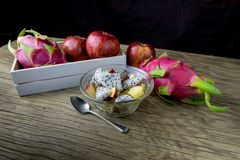 Fruit salad in a bowl on the wooden table. Selective focus. Royalty Free Stock Image