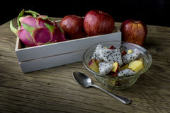 Fruit salad in a bowl on the wooden table. Selective focus. Royalty Free Stock Photo