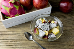 Fruit salad in a bowl on the wooden table. Selective focus. Royalty Free Stock Photos