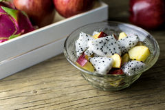 Fruit salad in a bowl on the wooden table. Selective focus. Stock Photography