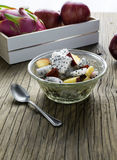 Fruit salad in a bowl on the wooden table. Selective focus. Stock Photo
