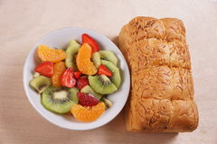 Fruit Salad and Bread. Bread and a bowl of salad fruits, fresh and colorful stock image