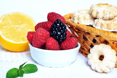 Fruit salad with cakes. Nice breakfast is on this photo, which includes fresh fruit salad and some cookies stock images