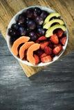 Fruit salad in a ceramic bowl Stock Photos