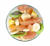 Fruit salad with citrus in a glass bowl Royalty Free Stock Photos