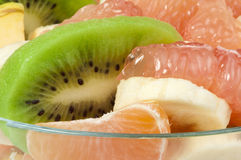 Fruit salad with citrus in a glass bowl Royalty Free Stock Images