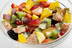 Fruit salad close up. Mixed fresh fruit chunks close up Stock Image