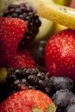 Fruit salad close up. Close up of kiwi,banana ,strawberry and blackberry, that make up a fruit salad Stock Photos