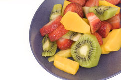 Fruit salad. Close up of fruit salad on purple plate Royalty Free Stock Image