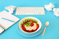 Fruit salad concept of a healthy snack at work. Royalty Free Stock Photos