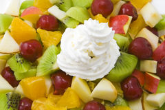 Fruit salad with cream. Colorful fruit salad with cream Royalty Free Stock Photo