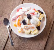 Fruit salad with cream. Fruit salad with cream  banana strawberry orange and  mulberry Stock Photos