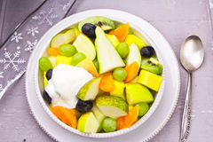Fruit salad with cream. On festive table Royalty Free Stock Photos
