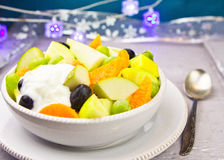 Fruit salad with cream. On festive table Royalty Free Stock Images