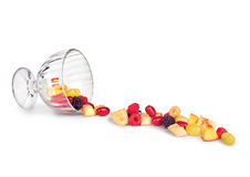 Fruit salad falls from glass bowl Royalty Free Stock Photos