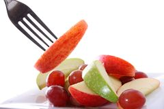 Fruit salad and fork Royalty Free Stock Photo