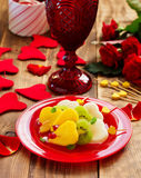 Fruit salad in the form of hearts Stock Images