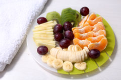 Fruit salad. Fresh fruit salad in a glass plate Royalty Free Stock Photo