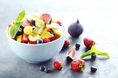 Fruit salad. Fresh fruit salad on a grey wooden table Stock Images