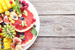 Fruit salad. Fresh fruit salad on a grey wooden table Royalty Free Stock Images