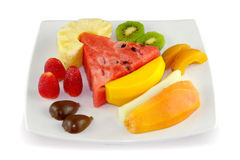 Fruit salad. Fresh fruit salad on a white plate Royalty Free Stock Photography