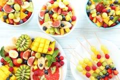 Fruit salad. Fresh fruit salad on a white wooden table Stock Photos