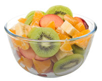 Fruit salad in glass bowl. Isolated on white background Royalty Free Stock Photo