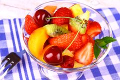 Fruit salad in glass bowl with dessert fork Royalty Free Stock Photography