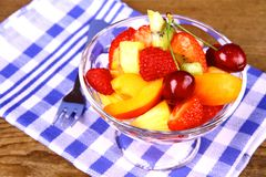 Fruit salad in glass bowl with dessert fork Stock Photography