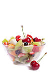 Fruit salad in a glass bowl. Isolated over white Stock Photography