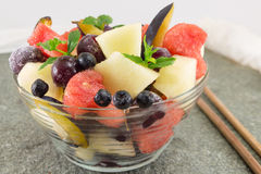 Fruit salad in a glass bowl Stock Images