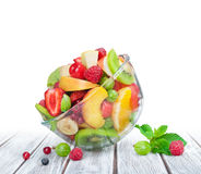 Fruit salad in glass bowl white wooden table Stock Photos