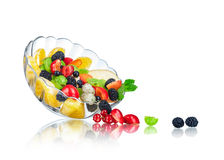 Fruit salad in a glass salad bowl with reflection Stock Photos