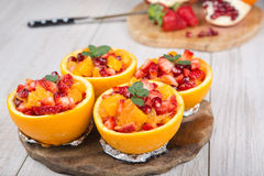 Fruit salad in hollowed-out orange Royalty Free Stock Photo