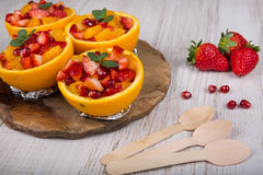 Fruit salad in hollowed-out orange Stock Photography