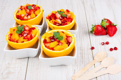 Fruit salad in hollowed-out orange Stock Photos