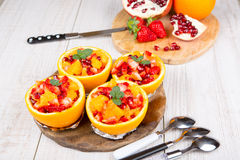 Fruit salad in hollowed-out orange Royalty Free Stock Photography