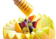 Fruit salad with honey Stock Photos
