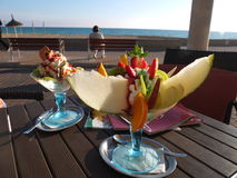 Fruit salad with ice cream. In glass royalty free stock photos