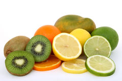 Fruit salad ingredients lemon lime kiwi mango and orange Royalty Free Stock Photos