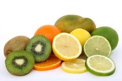 Fruit salad ingredients lemon lime kiwi mango and orange Royalty Free Stock Photos