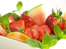 Fruit salad on isolated background Stock Photo
