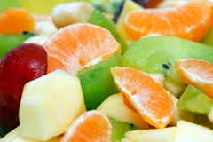 Fruit salad. Of kiwi, apple, plum, tangerine and banana in the salad-bowl Royalty Free Stock Photos