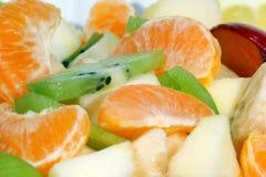Fruit salad. Of kiwi, apple, plum, tangerine and banana in the salad-bowl Royalty Free Stock Photo