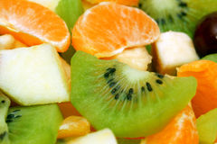 Fruit salad. Of kiwi, apple, plum, tangerine and banana in the salad-bowl Royalty Free Stock Images