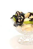 Fruit salad with kiwi and banana with chocolate sauce.  Royalty Free Stock Photography