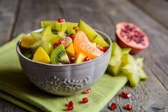 Fruit salad with kiwi, mango, mandarin, carambola and pomegranate Royalty Free Stock Image